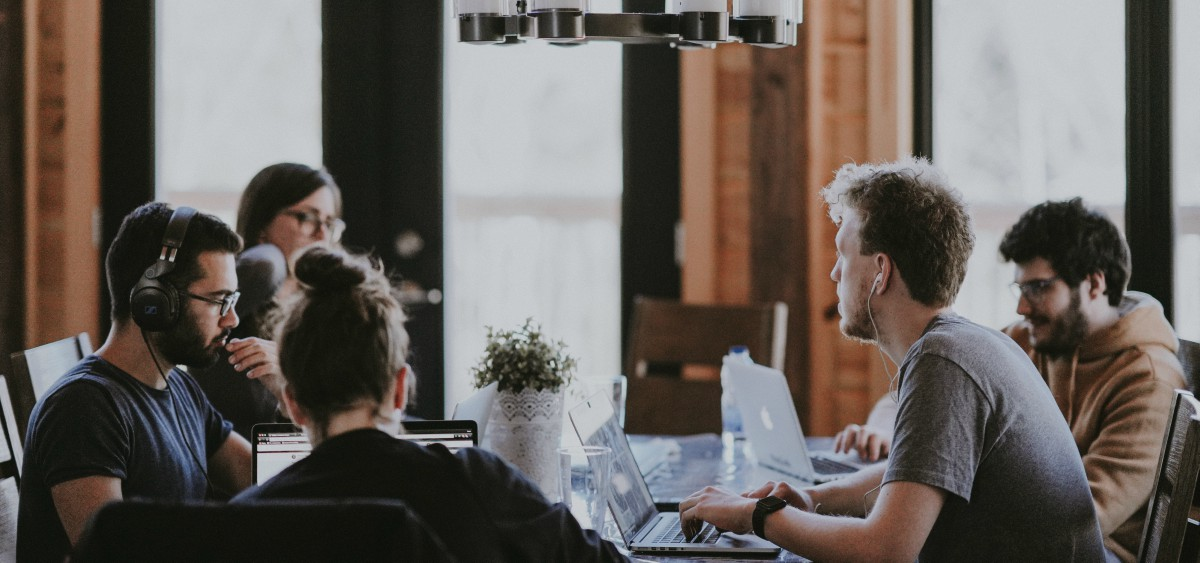 people sitting around a table in a coworking space