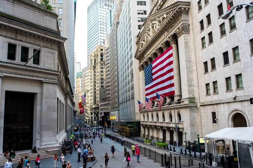 New York, NY: August 27, 2016: Flag draped NYSE on Wall Street. The New York Stock Exchange (NYSE) is the largest stock exchange in the world by market cap.; Shutterstock ID 542390482; Departmental Cost Code : 162800; Project Code: GMKT_SUP_4.9.1E; PO Number: GBLMKT/2015-082